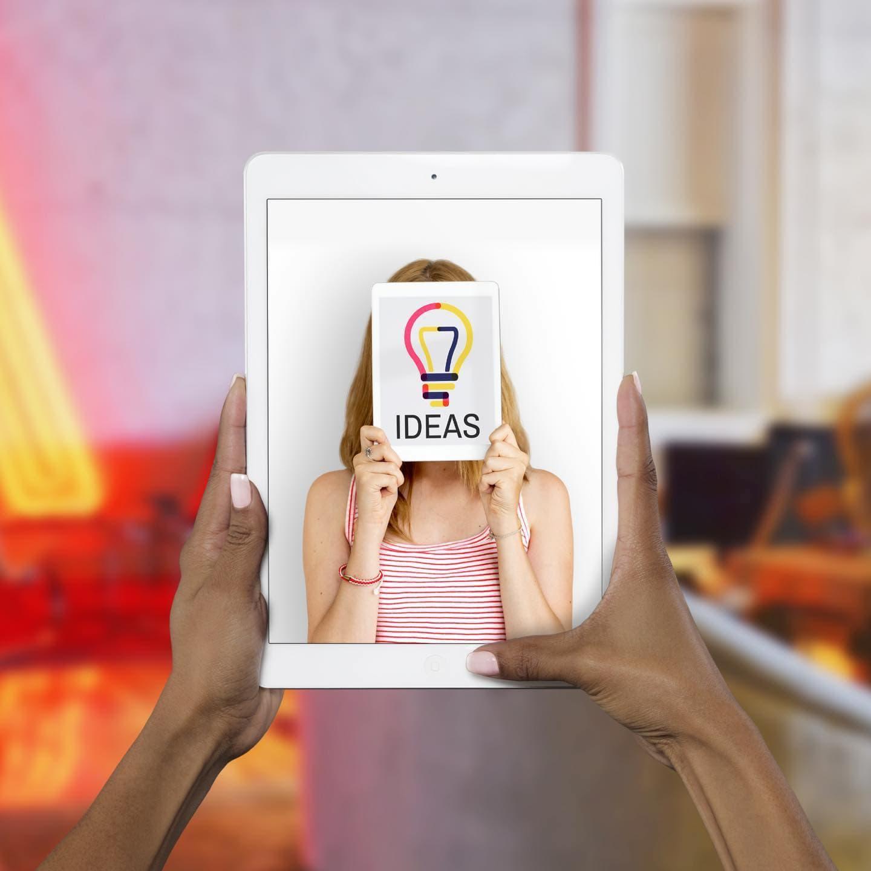 freeui.design_envato-elements-envato-elements-idea-iPad-on-Hand-PSD-Mockup-v2